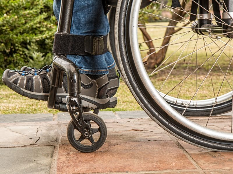 Feet strapped into wheelchair supports